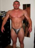 pumpedup bodybuilder showing big muscles.jpg