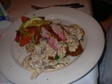 Panko-Scallion & Ginger-Crusted Tuna - Wild rice, stir-fried vegetables & shitake mushroom cream sauce.