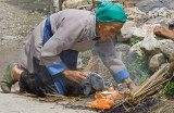 Chinese Women in Bai-village near Dali cooking her meal on the street