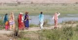 Indian attire:  Salwar-kameez (2 on left) & saris