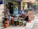 A pottery shop at the Bat Trang ceramic village with the items for sale out in front.