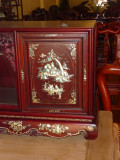 Everything is artistically carved and also inlaid with mother-of-pearl in seven colors.