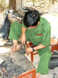 This craftsman was making sandals out of used tires.  Ho Chi Minh used to wear them.