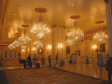 The hotel lobby with ornate crystal chandeliers in the Paris Casino Resort.
