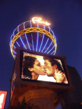 Beneath the balloon is this provocative billboard of a sexy couple kissing.