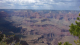 The canyon is 277 miles (446 km.) long, ranges in width from 4 to 18 miles (6.4 to 29 km.) and attains a depth of over a mile.