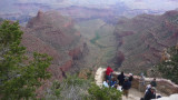 Tourists taking in the view from a precipitous South Rim vantage point.