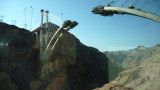 View from a bus window of a new bridge that was being constructed traversing the Black Canyon.