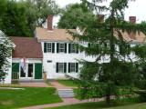 The Franklin Pierce Manse is a two-story frame building with a hipped roof.