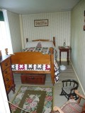 The small narrow shed bedroom. Calvin learned to make quilts when he was a boy.