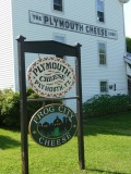 Sign for the Plymouth Cheese Factory, built by Colonel John Coolidge, James S. Brown and three other local farmers in 1890.