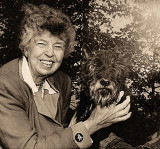 A happy photo of Eleanor Roosevelt with Fala, which symbolizes the true happiness that she found living at Val-Kill Cottage.