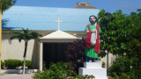 A religious statue in front of a San Pedro church