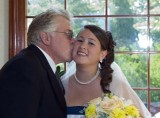 A kiss before the Bride is escorted down the aisle.