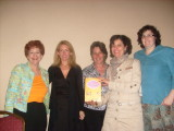 Kathryn Stockett (in black) surrounded by librarians