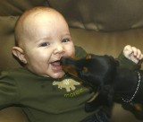 Ohhhh......Alessio experiences his first puppy kiss