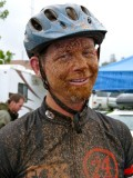 Alex Anderson is mud-covered during his 8-hour solo race at Cool.