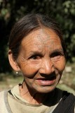 Khiamniungan Naga lady near Noklak with tattoos that shall ward off tigers.