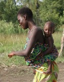 Mother and child dancing in Benin.