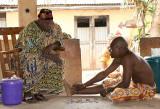 Voodoo priest in Abomey doing okpele ifá oracle.