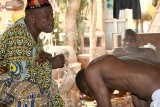 Voodoo priest in Abomey during a healing ceremony.