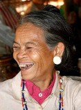 Happy Kreung lady during the pre-harvest celebration.