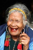 Old Phnong lady with traditional earrings. Pu Tang Village, Mondulkiri, Cambodia