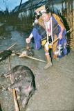 Myoko Priest with pig. Apatani tribe