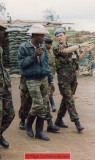 Major Mark Cuthbert-Brown walks through Kibeho with Captain Shema of the RPA, Indicating the direction in which the mass of IDPs fled on 22 April. (Photograph taken by John Cleland using the camera of Mark Cuthbert-Brown.)