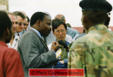Bizimungu, surrounded by UN officials (including RR Hasegawa and Randolph Kent - Head of the UN's Rwanda Emergency Operation) and RPA soldiers, is interviewed by local radio.