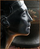 Detail of statue of Egyptian queen, Nefertiti with antique Chinese vase in the background