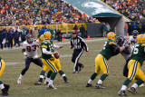 Aaron Rodgers (12) drops back to pass