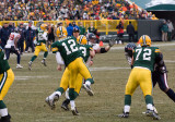 Aaron Rodgers (12) throws downfield