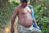 Our guide Omar and his leaf-tattooed belly