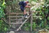 Steve climbing a fence