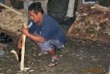 Omar chopping firewood