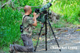 Ku Kok On on his knee with his Nikon 82 Field Scope  begging the target bird not to fly off!