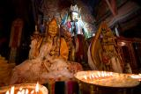 Various images of Buddha and Bodhisattvas with Yak butter offerings in front.