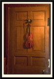 Trompe l'Oeil Violin and Bow Hanging on a door, c.1723