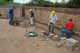 Lesley, Tracey & Bob start the bricklaying