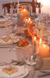 Scattered Candles with conch shell centerpiece - Photo by Kevyn Spiro