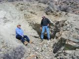 A couple trekers at a mine entrance