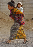 Mother Running Carrying Child