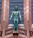 Statue over the West door by Dame Elizabeth Frink