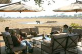 On the deck at Savuti overlooking a watering hole