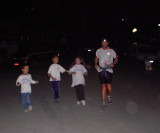 kids run with the runners down the hill and into the aid station