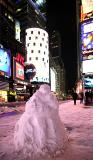 Times Square snow being...