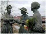suffragettes holding flowers...