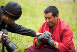 Jason asked a monk to wear his gloves for a photograph