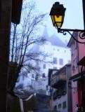 A castle into a bluish fog....